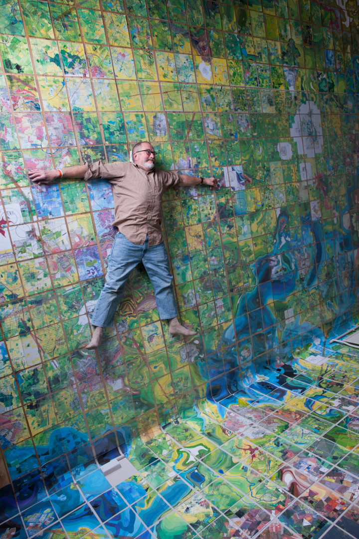 Artist Jerry Gretzinger with his fictional map artwork.
