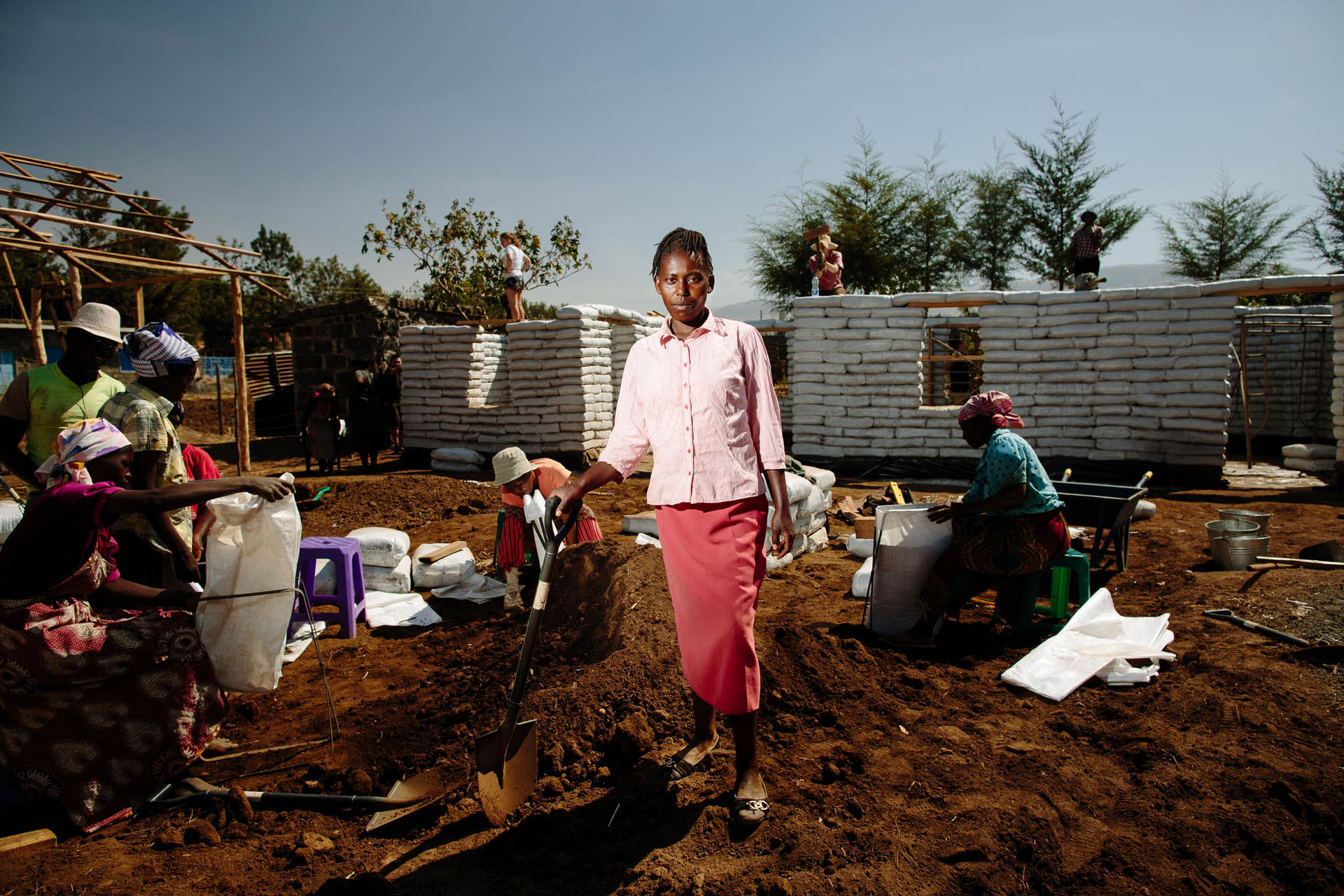 Worker on the £1K House building site, Nakuru, Kenya. Commissioned by Orkidstudio